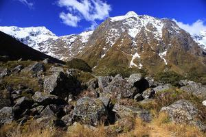 Snow Covered Mountains on the Road to Milford Sound, South Island, New Zealand by Paul Dymond