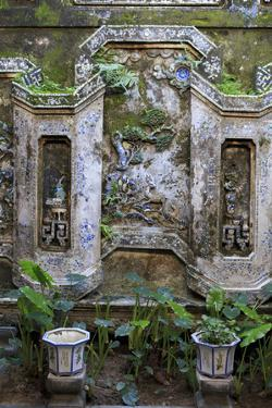 The wall of an inside courtyard in Quan Thang House in Hoi An, Vietnam by Paul Dymond