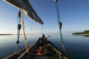 Bow of a Traditional Dhow with Sail in Mafia Island Coast of Tanzania by Paul Joynson Hicks