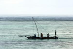 Fishing Boat in the Indian Ocean, Pre-Dawn, East Coast Unguja Island, Zanzibar, Tanzania by Paul Joynson Hicks