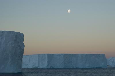 Moon Seeting over Massive Tabular Icebergs, South Georgia, South Atlantic by Paul Kay