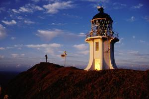 Dawn Light falling on the Lighthouse. by Paul Kennedy