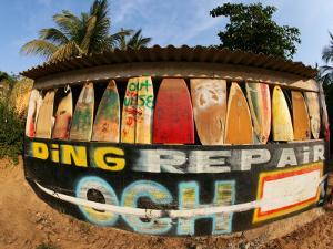 Surfboard Repair Shop, which has a Thriving Trade Due to the Heavy Waves by Paul Kennedy