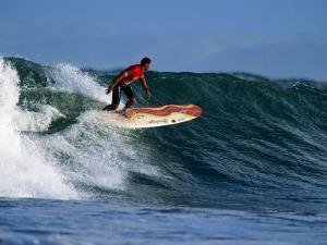 Surfer on Wave at Manu Bay, Raglan, New Zealand by Paul Kennedy