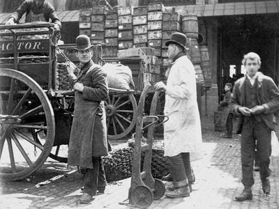Unloading at Billingsgate Market, London, 1893