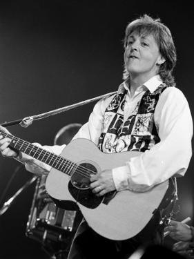 Paul McCartney Playing Guitar on Stage