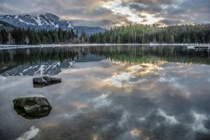 Lost Lake, so still it gives a perfect reflection of the sunset, ski hill and surrounding forest, W by Paul Porter