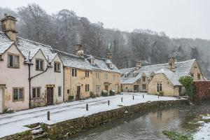 Snow covered houses by By Brook in Castle Combe, Wiltshire, England, United Kingdom, Europe by Paul Porter