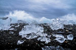 Water crashing over the ice and black sandy beach at Jokulsarlon, Iceland, Polar Regions by Paul Porter
