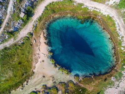 Aerial View of the Glavas Source of the Cetina River, Croatia. Source is over 110 M Deep. by paul prescott