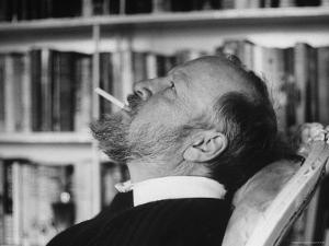 Author William Golding Relaxing in Chair While Cigarette, at Home in Village of Bower Chalk by Paul Schutzer