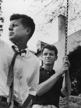 Bobby Kennedy, Chief Counsel of Sen. Comm. on Labor and Management, with Bro, Ma Sen. John Kennedy by Paul Schutzer
