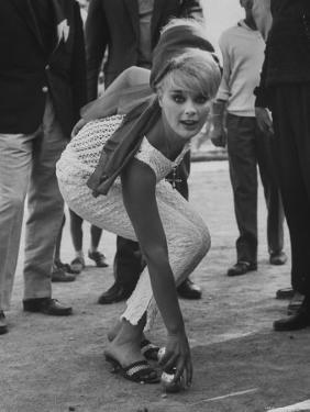 Elke Sommer Playing Petanque at the Cannes Film Festival by Paul Schutzer