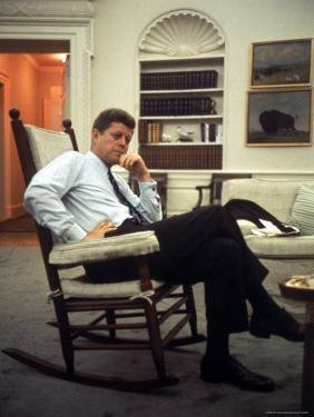President John F. Kennedy Sitting in Rocking Chair in His White House Office by Paul Schutzer