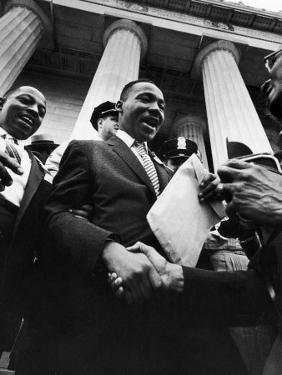 Reverend Martin Luther King Jr. Shaking Hands with Crowd at Lincoln Memorial by Paul Schutzer