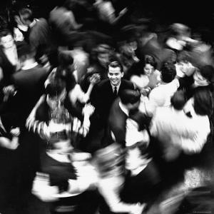 TV Host Dick Clark in Middle of Teenage Dancers on Dance Floor During American Bandstand Show by Paul Schutzer