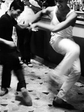 Two Young Italian Men Dancing to Music from a Jukebox in a Bar by Paul Schutzer