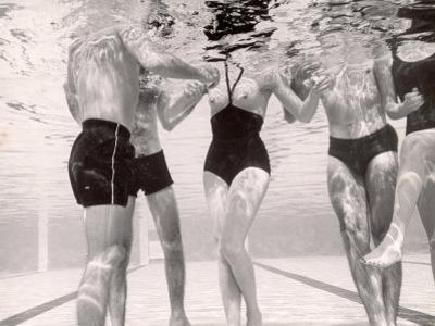 Underwater Shot of Actress Daphne Dayle in Topless, One Piece Swim Suit by Designer Ruben Torres