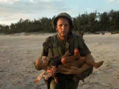 US Marine Holding an Injured Vietnamese Child