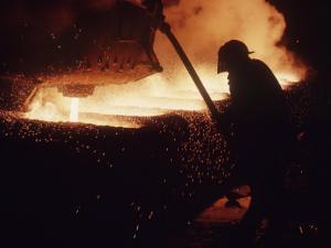 Worker Pouring Hot Steel at an Unidentified Brazilian Steel Plant by Paul Schutzer