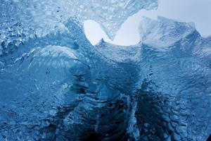 Antarctica, Cuverville Island, Close-up of scalloped surface of melting iceberg. by Paul Souders