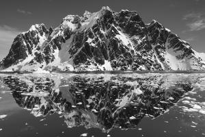 Antarctica, Mountain peaks reflected in the Lemaire Channel. by Paul Souders