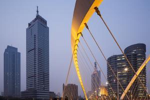 China, Tianjin, Dagu Bridge with Skyscrapers Rising Along Haihe River by Paul Souders