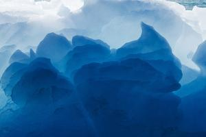 Greenland, Ilulissat, Midday sun lights melting iceberg near face of Eqip Glacier by Paul Souders