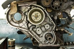 Land Rover Engine in Garage, Zambia by Paul Souders