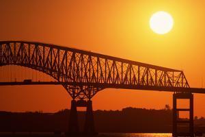 Sun Setting behind Bridge by Paul Souders