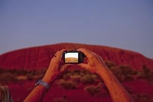 Tourist Photographing Ayers Rock in the Australian Outback by Paul Souders