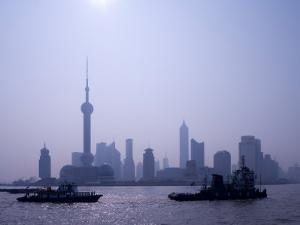 Water Traffic along Huangpu River Passing Oriental TV Tower and Pudong Skyline, Shanghai, China by Paul Souders