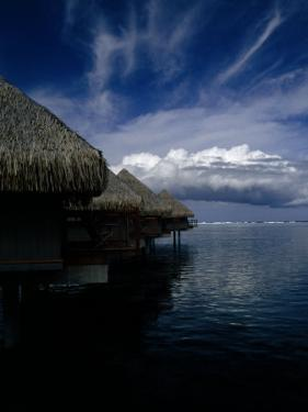 Hotel Bungalows over Water at an Exclusive Resort on Tahiti by Paul Sutherland