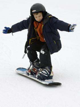 9 Year Old Boy Riding His Snowboard, New York, USA by Paul Sutton
