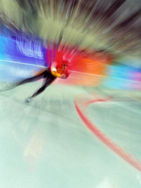 Blurred Action of Speed Skater by Paul Sutton
