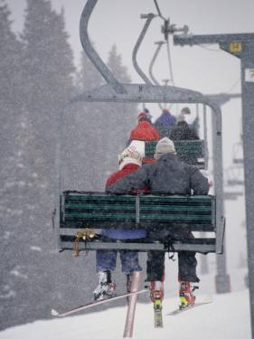 Couple Riding Up the Ski Lift During a Snow Storm, Vail, Colorado, USA by Paul Sutton