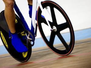 Detail of Cyclist Racing on the Velodrome Track, Athens, Greece by Paul Sutton