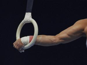 Detail of the Hands of Male Gymnast Grabing the Ring by Paul Sutton