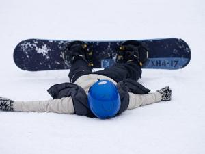 Female Snowboarder Collapsed after a Run, New York, USA by Paul Sutton