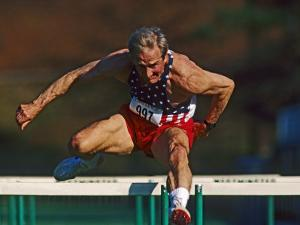 Mature Athlete Competes in Hurdles Race, Atlanta, Georgia, USA by Paul Sutton