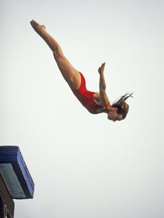 Woman Diver Flying Through the Air, California, USA by Paul Sutton