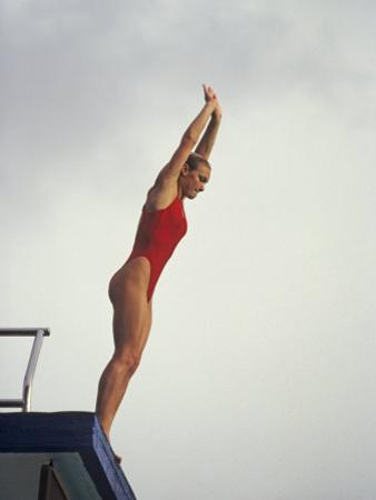 Women Diver Preparing to Jump Off the Platform, California, USA by Paul Sutton