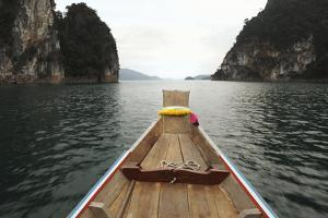Boat Moving through Khao Sok National Park by Paul Taylor