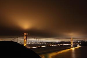 Golden Gate Bridge at Night, San Francisco in Back by Paul Taylor