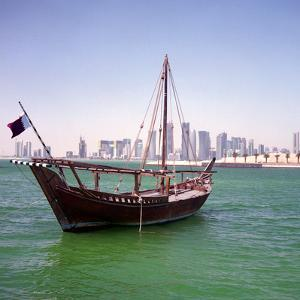 A Qatari Sailing Dhow, Called a Boom or Boum, with the National Flag Flying and the Doha Skyline by PaulCowan