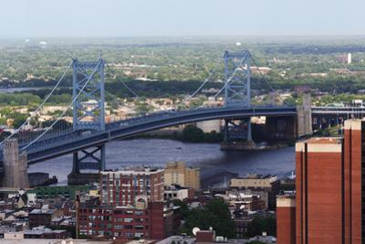 The Benjamin Franklin Bridge Crosses the Delaware River Connecting Philadelphia, Pennsylvania and C by pdb1