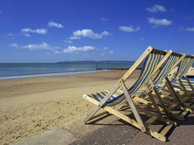 Deckchairs on the Promenade Overlooking Beach, West Cliff, Bournemouth, Dorset, England, UK by Pearl Bucknall
