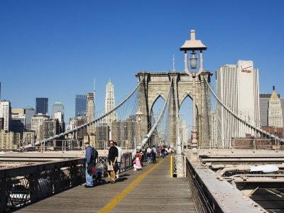 https://imgc.allpostersimages.com/img/posters/pedestrian-walkway-on-the-brooklyn-bridge-looking-towards-manhattan-new-york-city-new-york-usa_u-L-P1KBN80.jpg?p=0