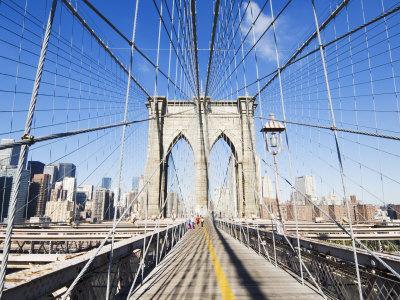 https://imgc.allpostersimages.com/img/posters/pedestrian-walkway-on-the-brooklyn-bridge-looking-towards-manhattan-new-york-city-new-york-usa_u-L-P1KBPE0.jpg?p=0