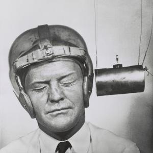 Pendulum Pounding a Plastic Helmet Worn for Testing to Improve Headgear for Football Players